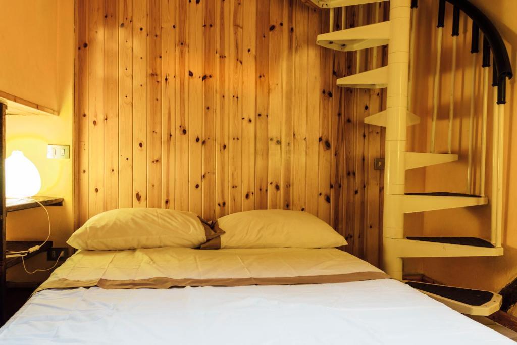 Letto o letti in una camera di Gombruti Suite Home 1
