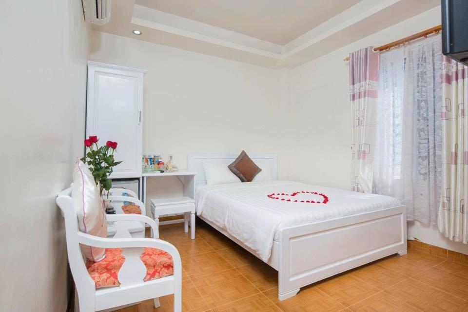 Кровать или кровати в номере Ken Hotel