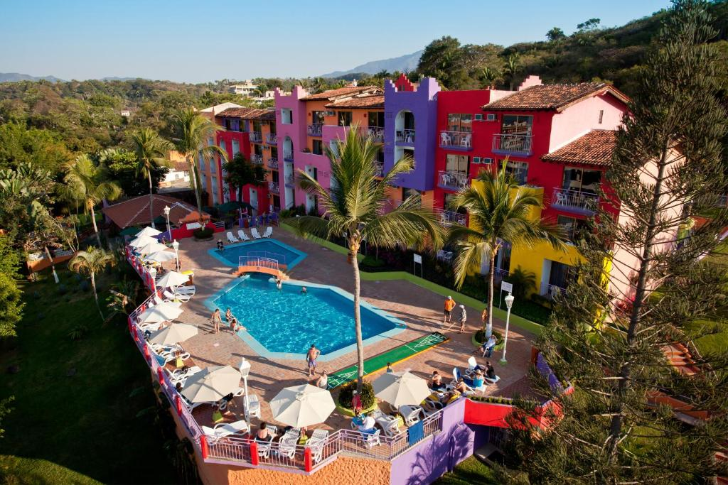 A view of the pool at Decameron Los Cocos - All Inclusive or nearby