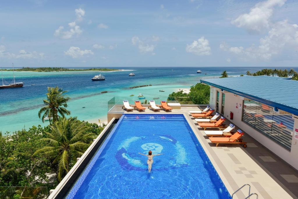 Bandos resort is a private island located 8 Km away from Male. Bandos Maldives features spacious rooms with balconies overlooking the garden or beach. A water sports centre and dive school are available. The hotel has multiple dining options.