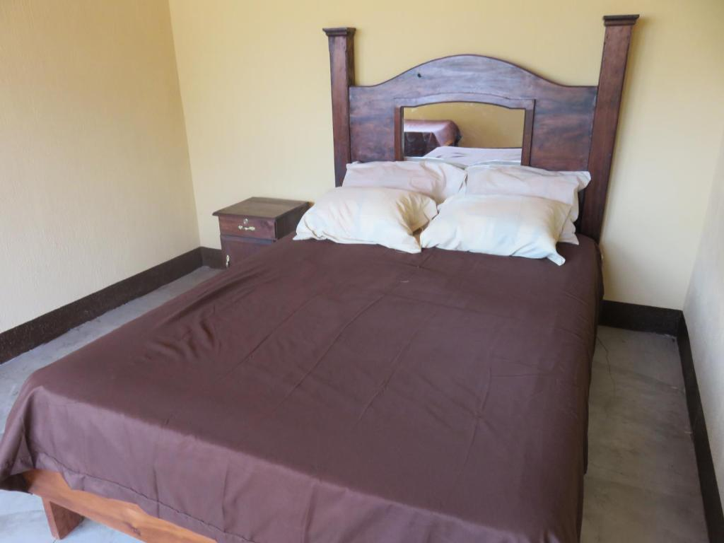 A bed or beds in a room at Cristalinas Cafe, Hotel & Restaurant at Lake Atitlan