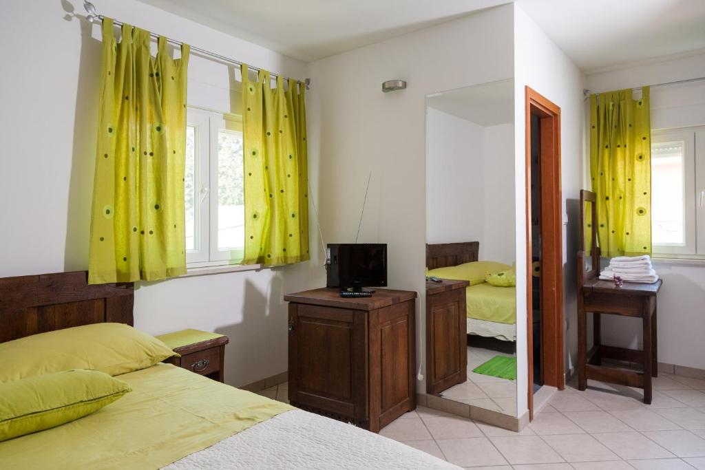 A television and/or entertainment center at Rooms Vesna