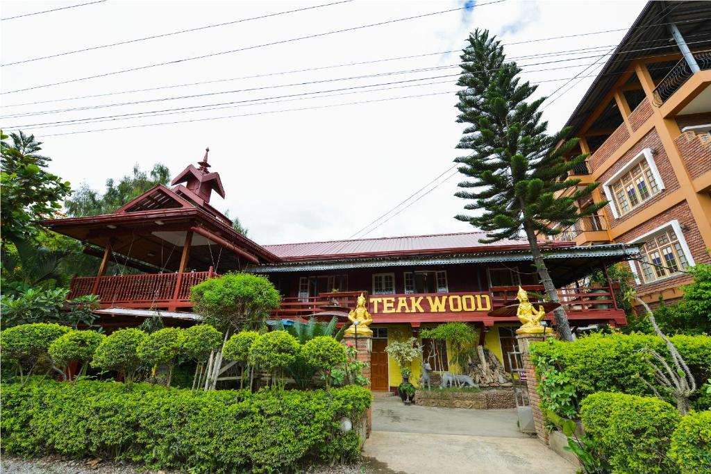 The facade or entrance of Teak Wood Hotel