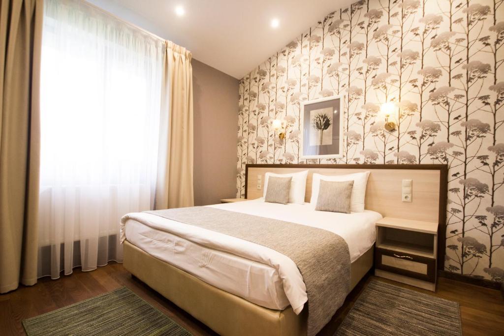 Кровать или кровати в номере Отель Палисад
