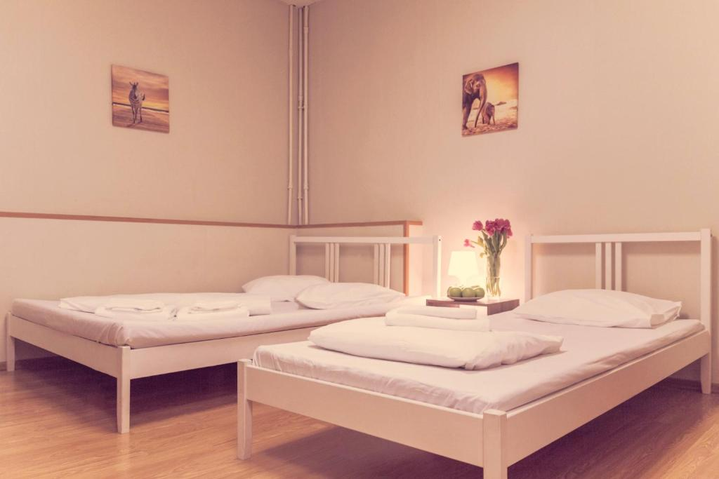 A bed or beds in a room at Arka Hotel on Krasnoselskaya