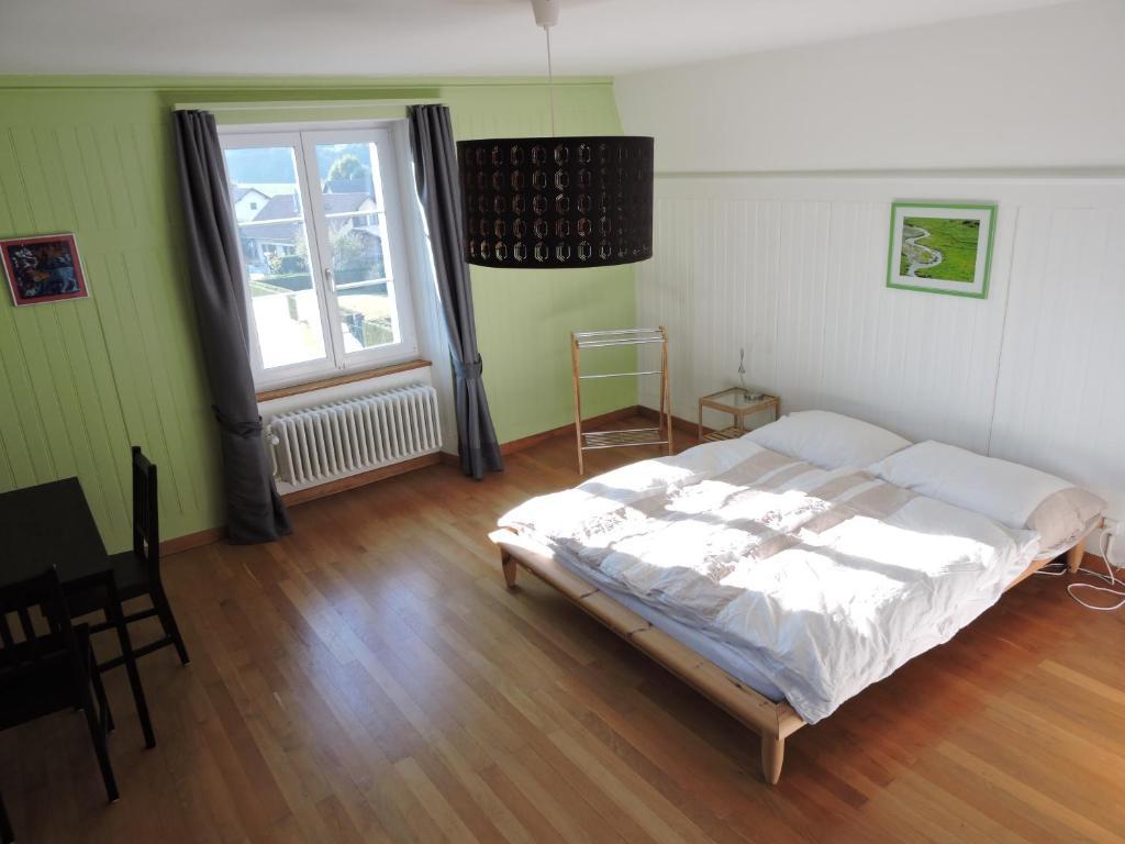Ein Bett oder Betten in einem Zimmer der Unterkunft VINITA Chambres d'hôtes