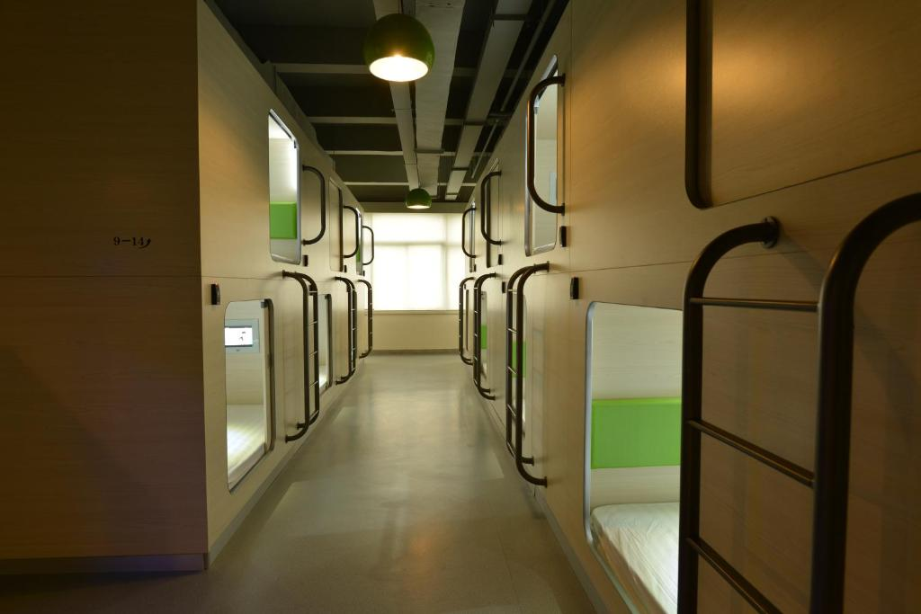 A bunk bed or bunk beds in a room at Shenzhen Xi You Hostel