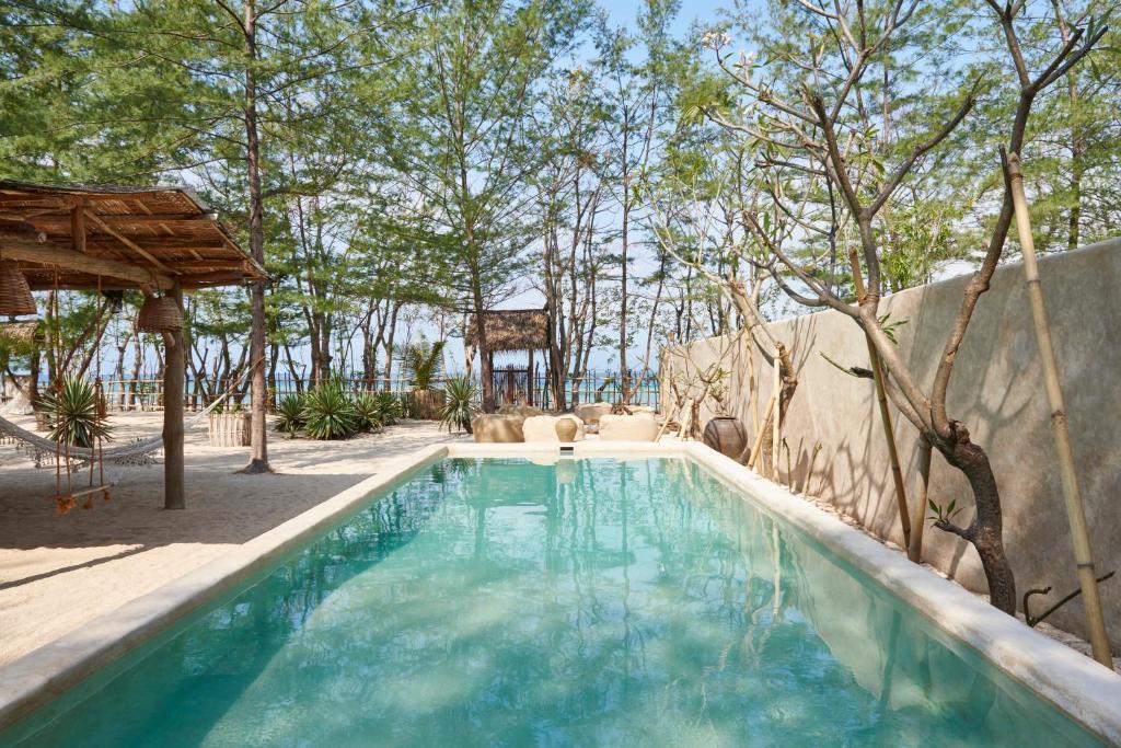 The swimming pool at or near The Island Houses Gili Meno