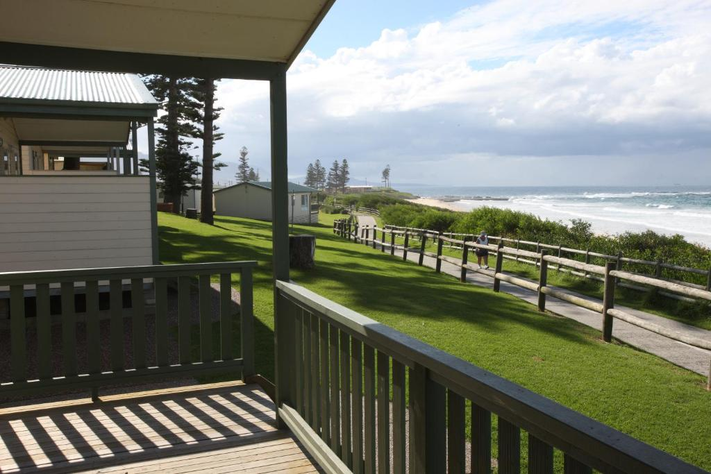 A balcony or terrace at Bulli Beach Tourist Park