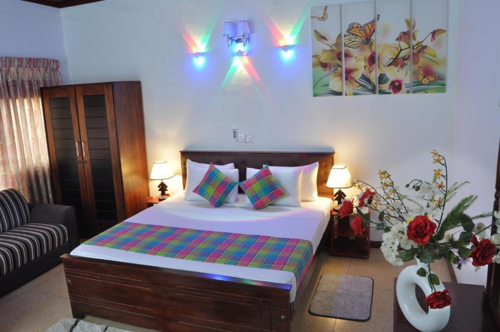 Кровать или кровати в номере Guest Ryan