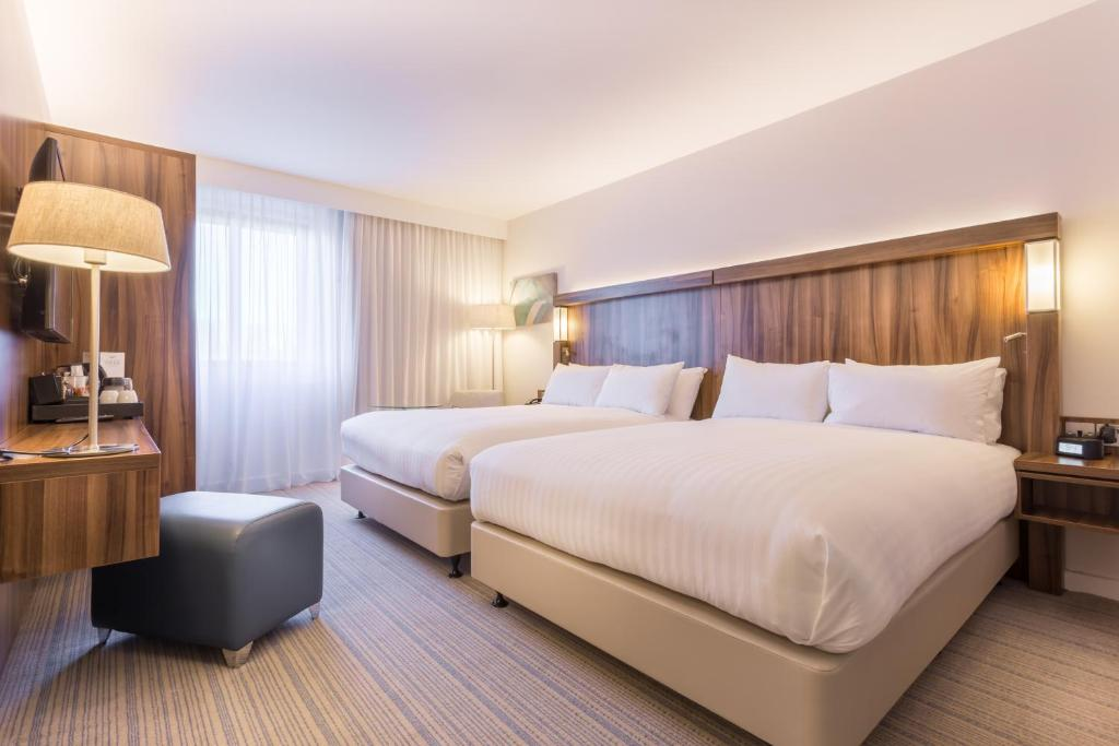 A bed or beds in a room at Courtyard by Marriott Glasgow Airport