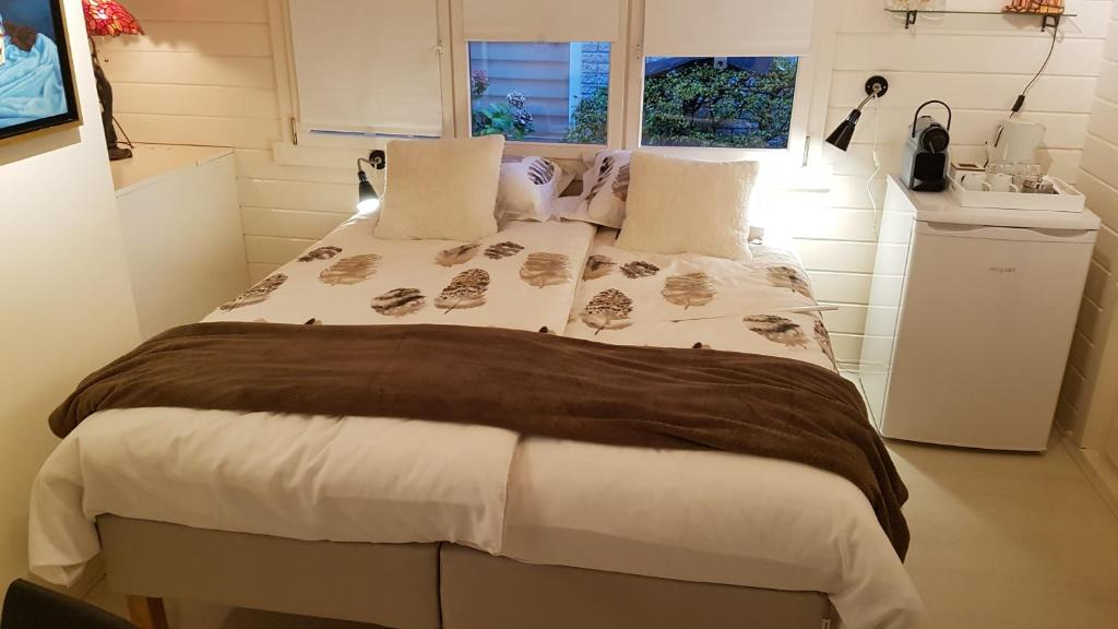 A bed or beds in a room at Studio QuaAmsterdam
