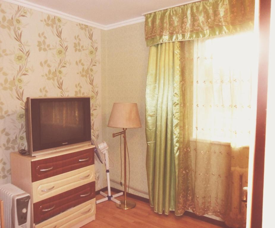 A television and/or entertainment center at Apartment on Zakarpatskaya Street