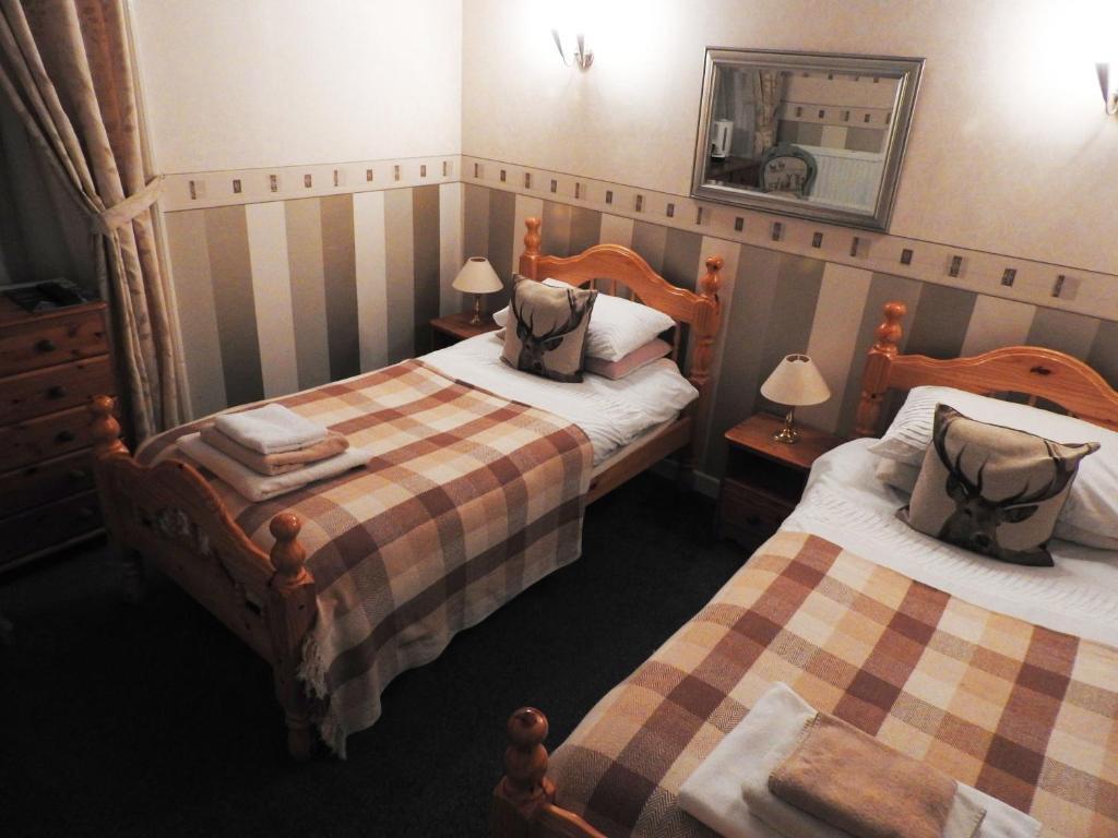 Llit o llits en una habitació de The Stag Head Hotel