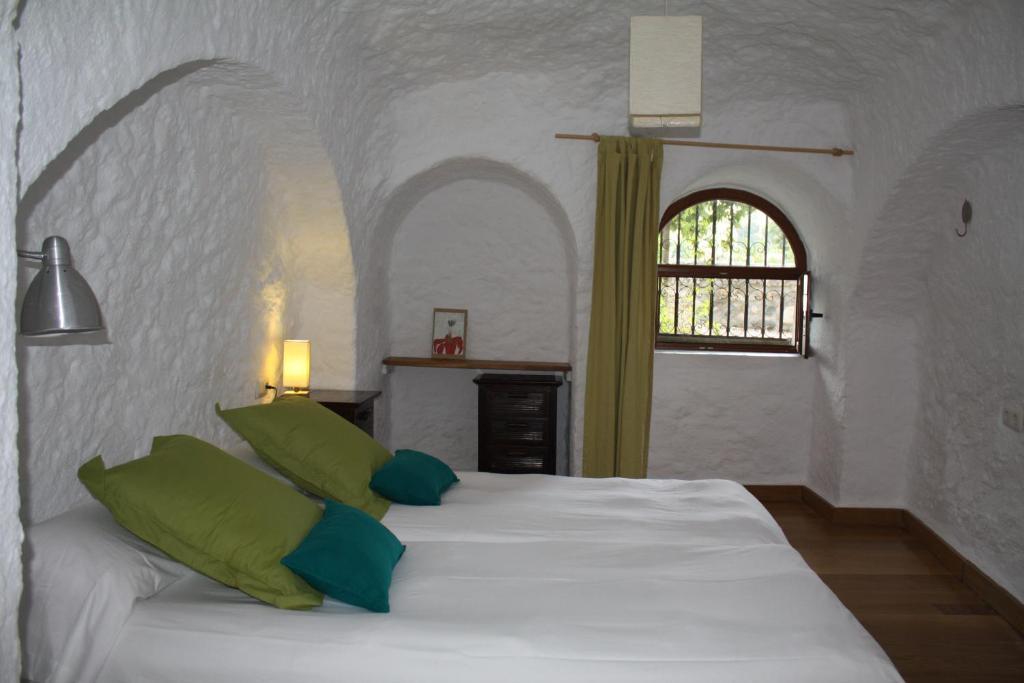 Cama o camas de una habitación en Cueva Los Naranjos