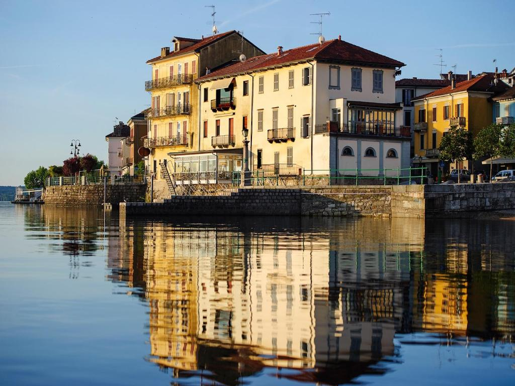 Aparthotel arona including photos for Reservation hotel italie
