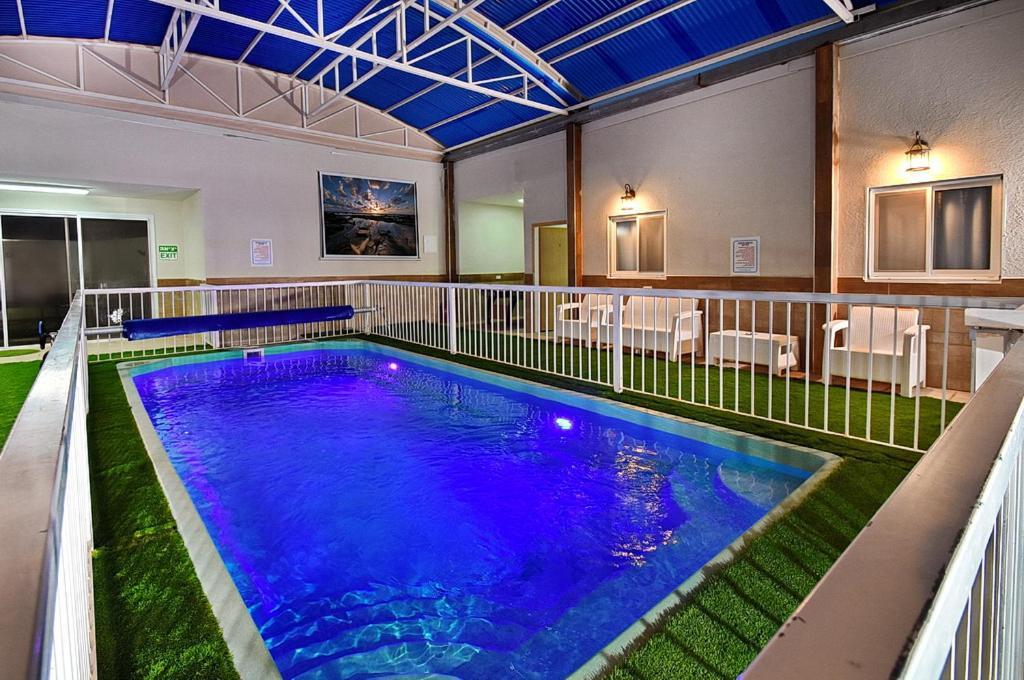 Der Swimmingpool an oder in der Nähe von Mansion Don Leone