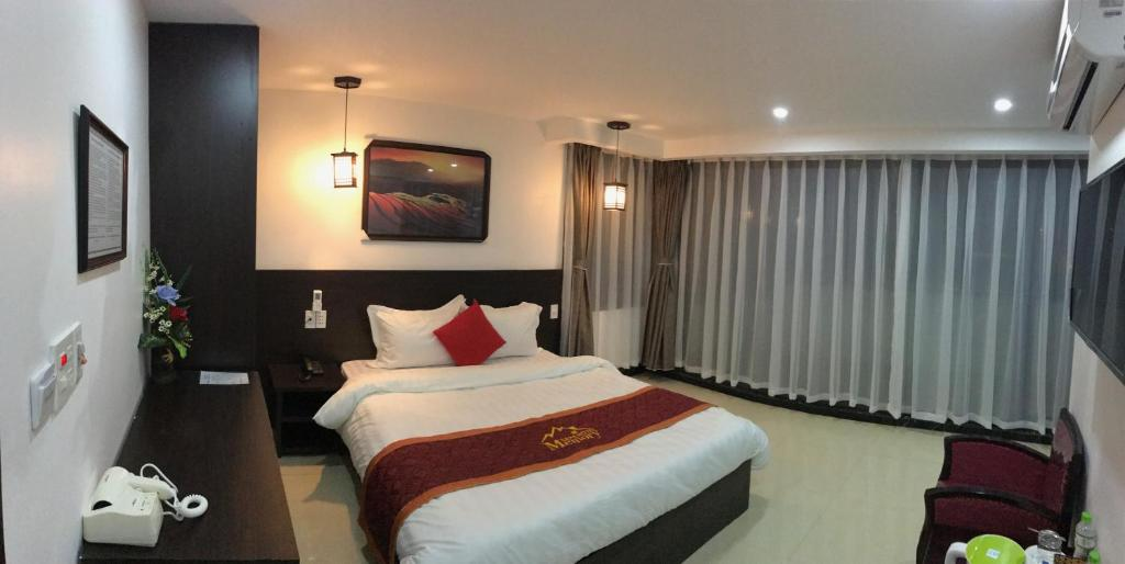 A bed or beds in a room at Sapa Memory Hotel