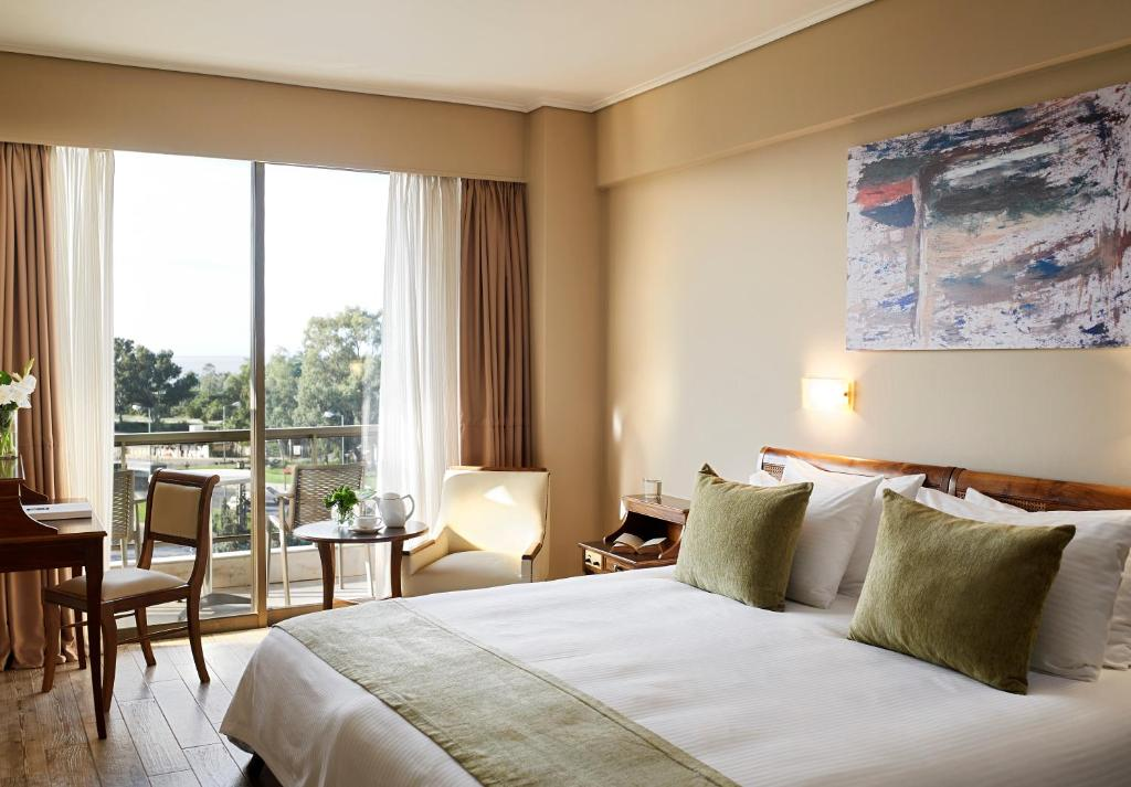 A bed or beds in a room at Golden Sun Hotel