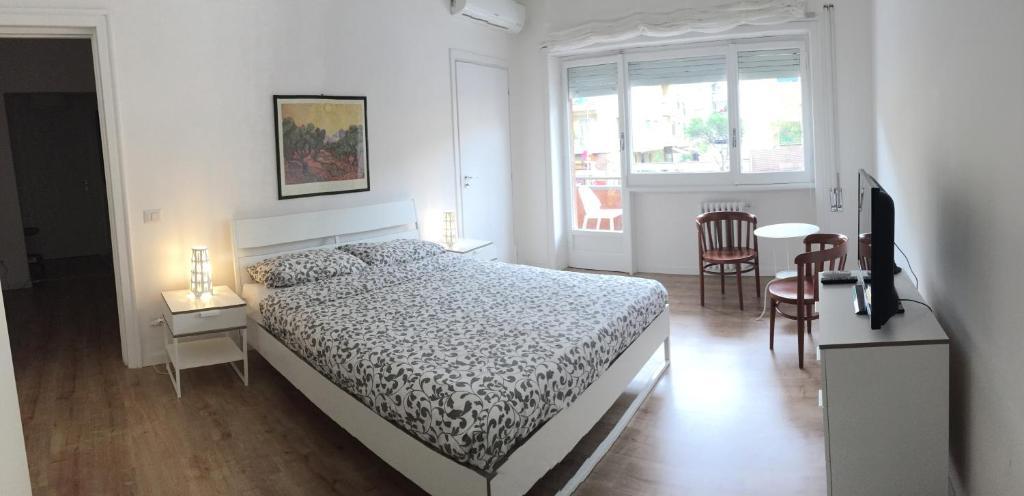 A bed or beds in a room at Claudio Vaticano appartamento