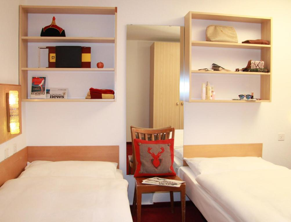 A bed or beds in a room at Petit Steffani Hostel