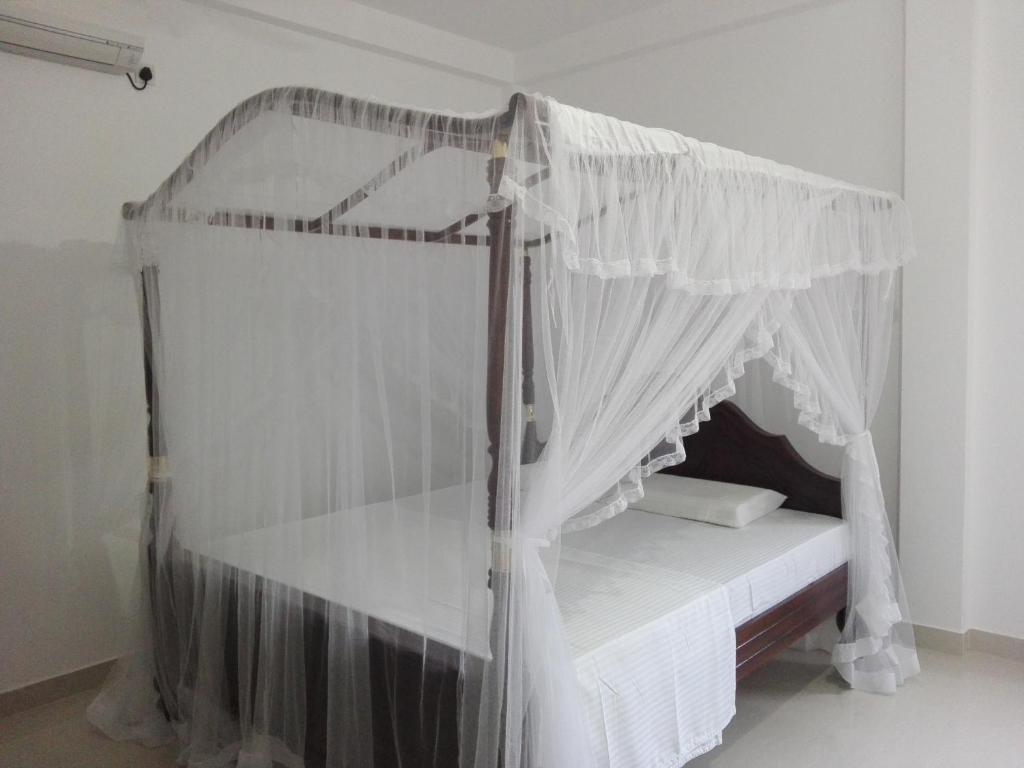 Кровать или кровати в номере Mirissa Cocoon