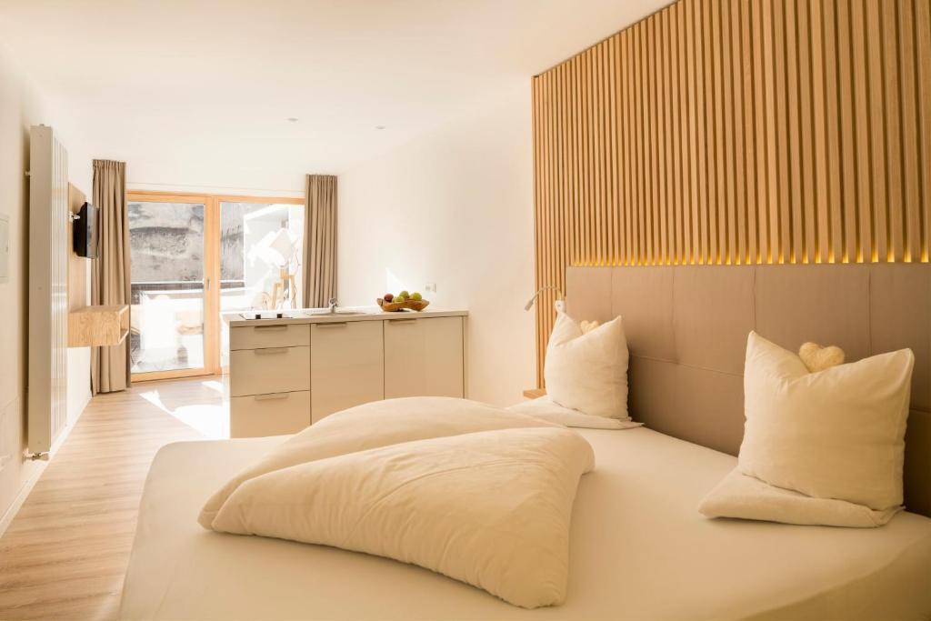 Ein Bett oder Betten in einem Zimmer der Unterkunft Hotel Schwarzer Widder