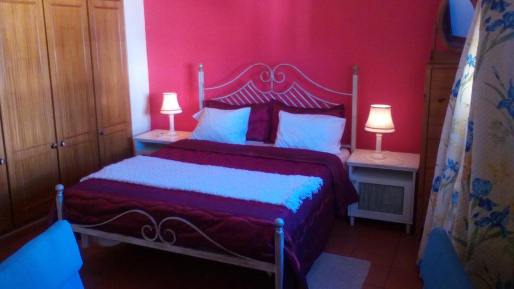 Katil atau katil-katil dalam bilik di Casa à Porta do Torreão