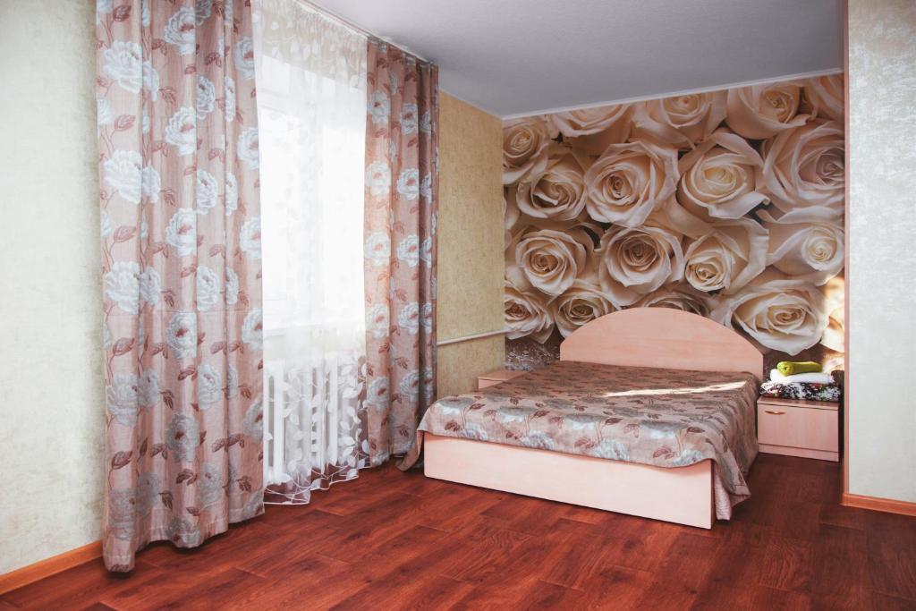 Кровать или кровати в номере Apartamenty Kalina na Zavodskaya 4