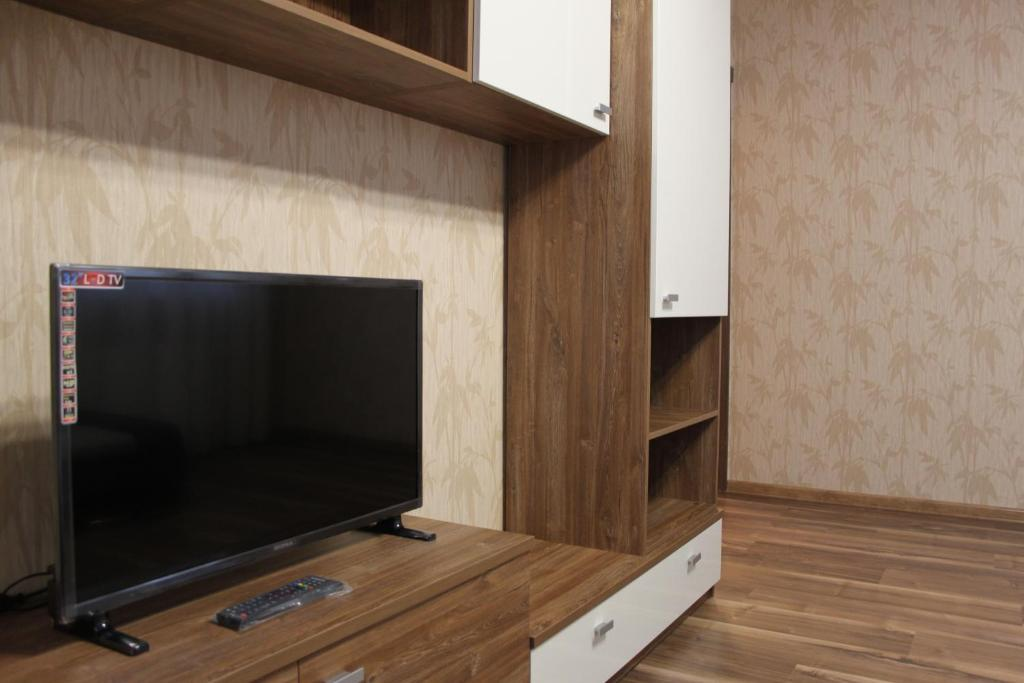 A television and/or entertainment center at Classic Red Apartment