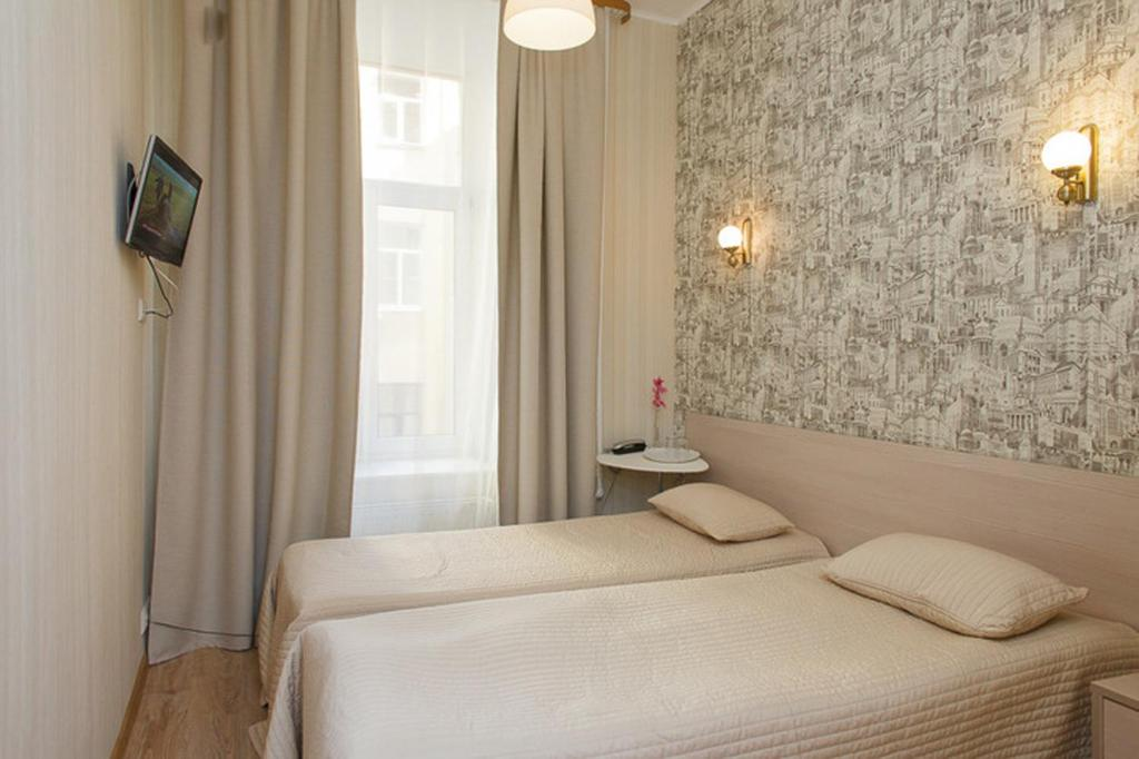 A bed or beds in a room at Аtmosphera - Central Inn