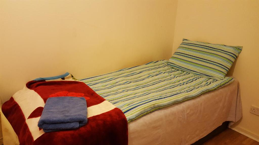 A bed or beds in a room at Cherry House & Self Catering