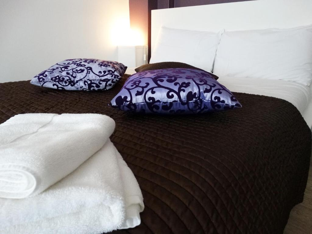 A bed or beds in a room at Ava Residence
