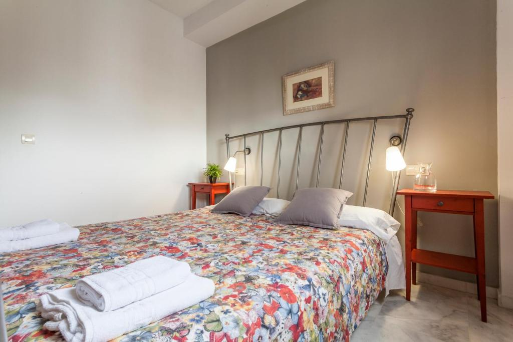 A bed or beds in a room at Apartamento La Salle