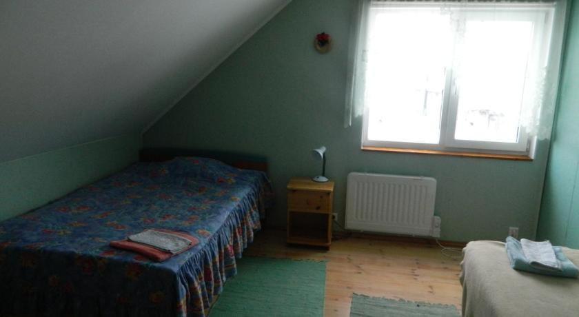 Voodi või voodid majutusasutuse Guesthouse Valentini toas