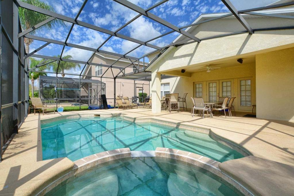 8010 arcadia estates court pool home orlando updated for Pool design orlando florida