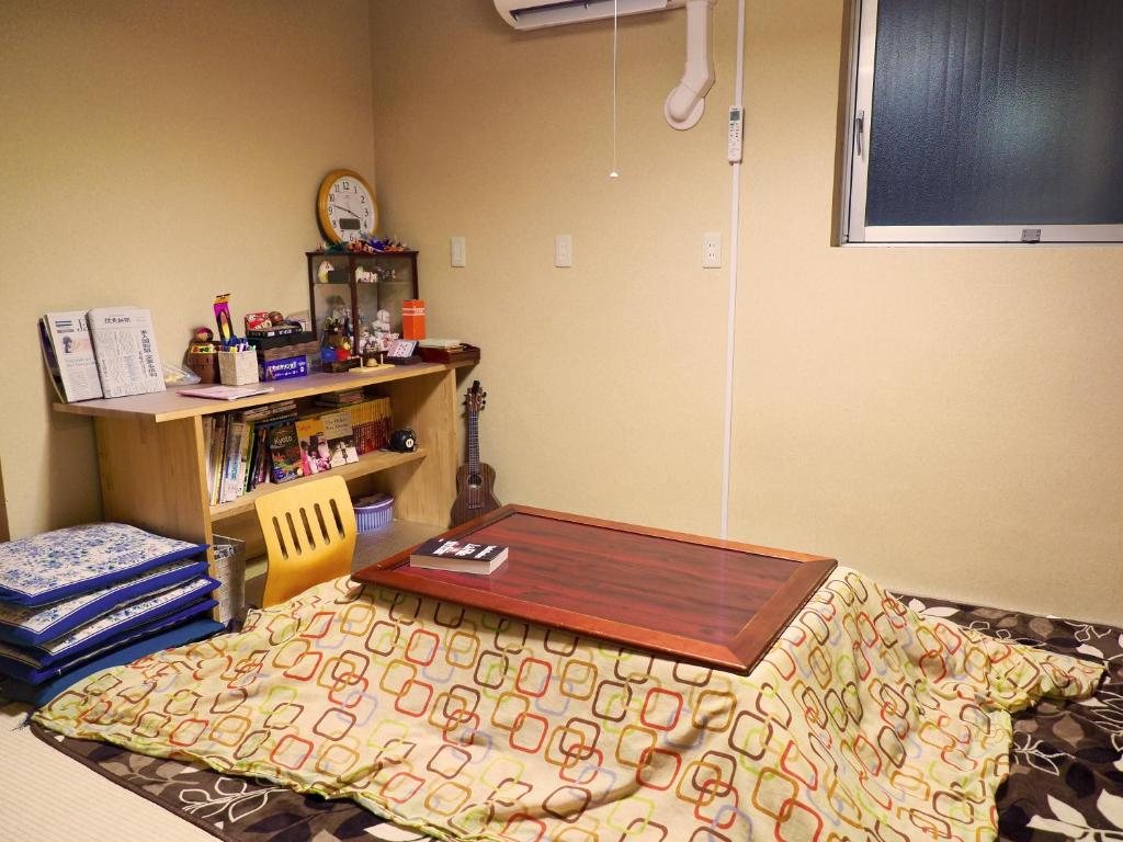 A bed or beds in a room at Yokohama Central Hostel