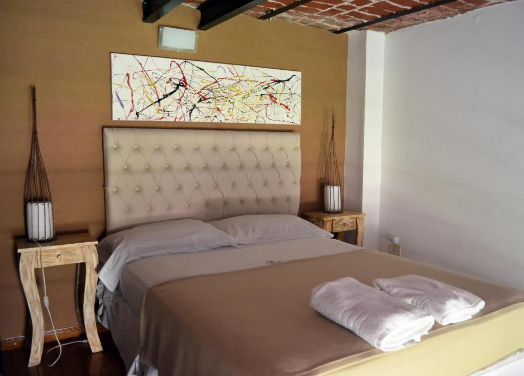 A bed or beds in a room at Puerto Delta