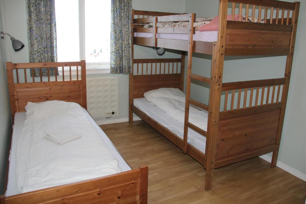 A bunk bed or bunk beds in a room at Country House Tokastaðir