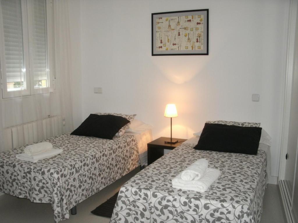 Ein Bett oder Betten in einem Zimmer der Unterkunft Luz de Chamberí