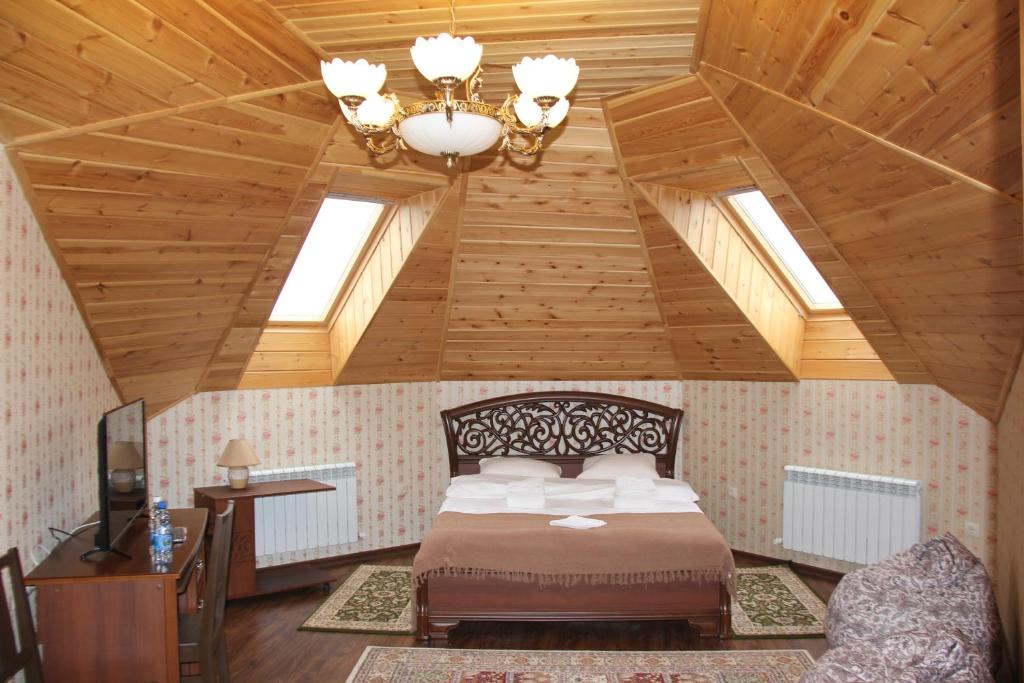 Кровать или кровати в номере Отель «Барин»