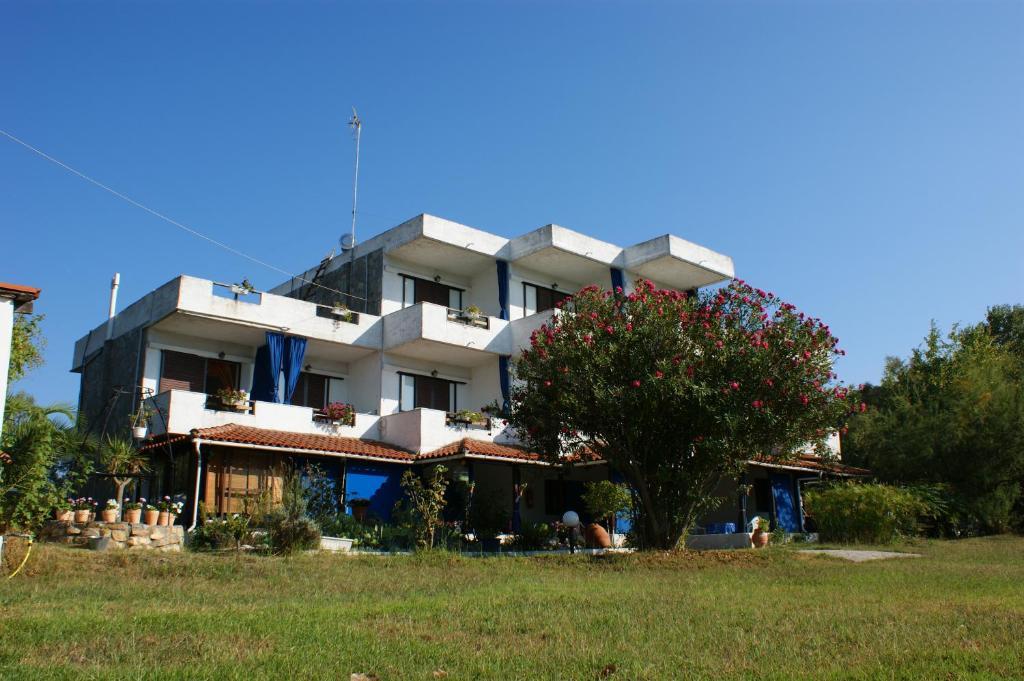Дом в остров Ормос Панагиас фото цены