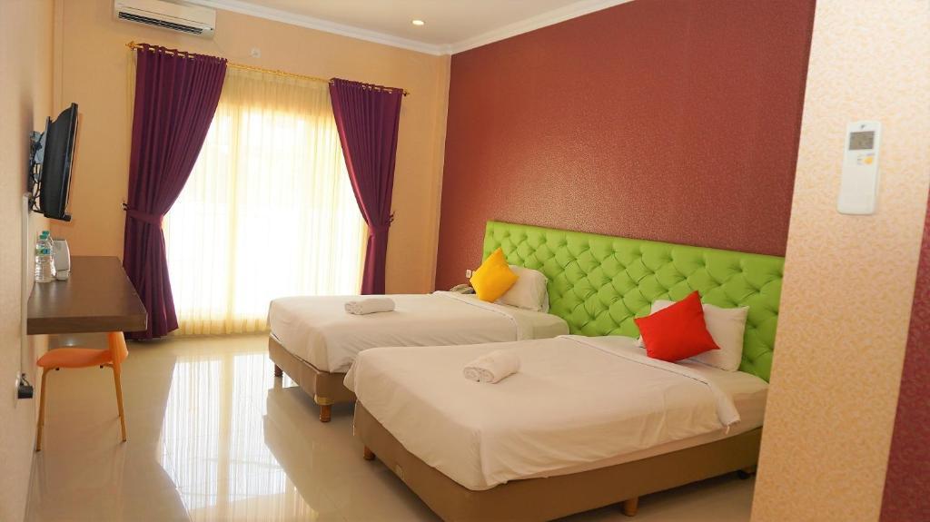 En eller flere senge i et værelse på Gowin Hotel