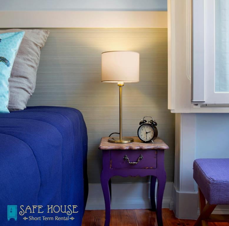 A bed or beds in a room at Safe House
