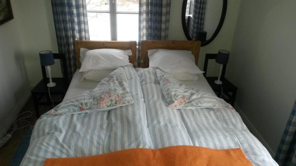 Säng eller sängar i ett rum på Orkesta Lundby Gård