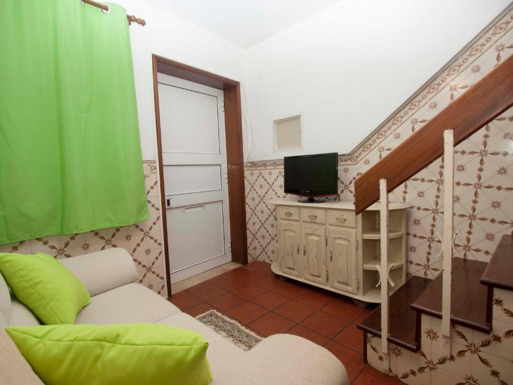 A television and/or entertainment center at Casa no Rossio