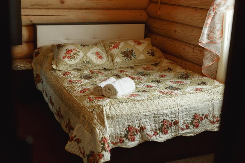Кровать или кровати в номере Usadba Hotel