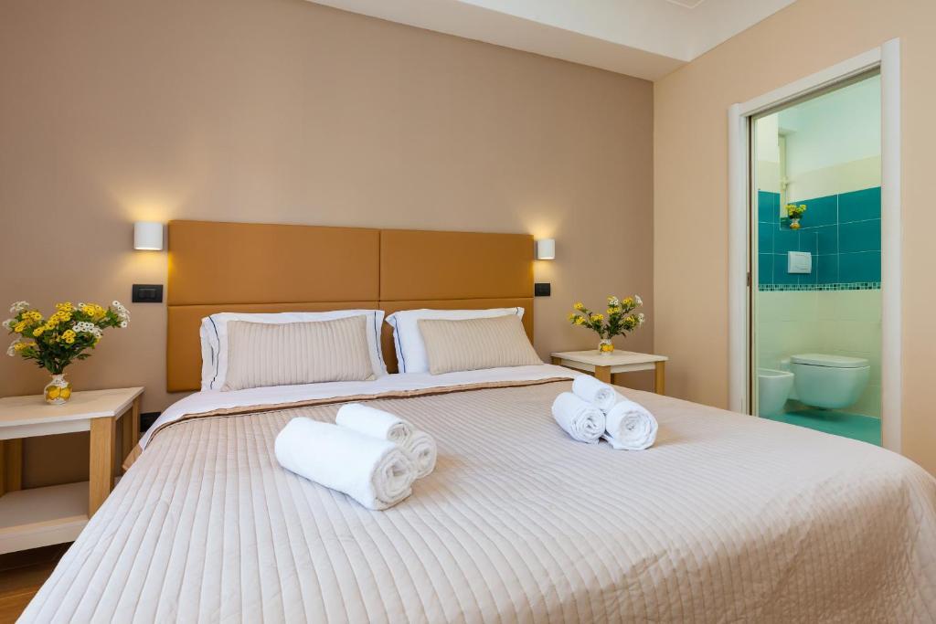 B&B Giacomino tesisinde bir odada yatak veya yataklar