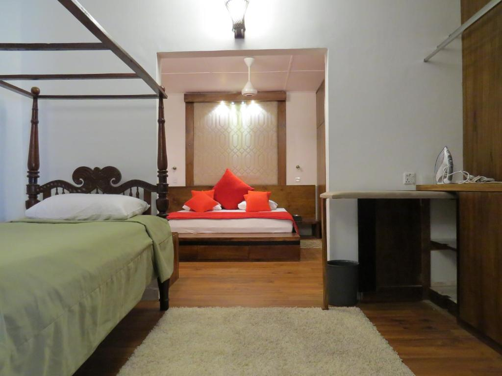 A bed or beds in a room at Dees Homestay Colombo