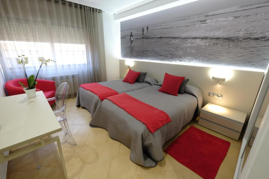 A bed or beds in a room at Hotel Vila da Guarda